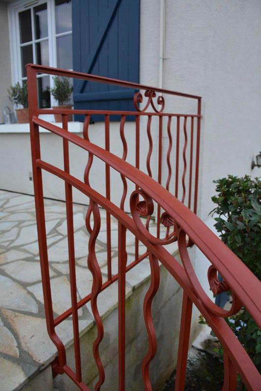 Rampe d'escalier à clo de cygnes